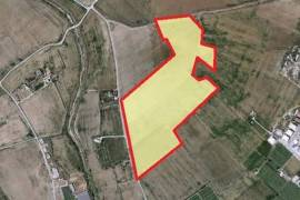 For sale a huge piece of agricultural and industrial land in Tersefanou.
