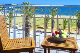 Seafront apartments hotel on the beach road of Rethymno town Crete